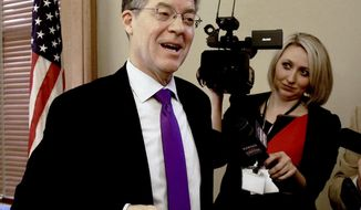 Kansas Gov. Sam Brownback reacts Wednesday, Jan. 24, 2018, to the news that his nomination to become ambassador-at-large for international religious freedom advanced Wednesday on a tied procedural vote broken by Vice President Mike Pence. Brownback had just finished presiding over the State Finance Council, which voted to approve a $362 million rebuild of Lansing Correctional Facility. (Thad Allton/Topeka Capital-Journal via AP)