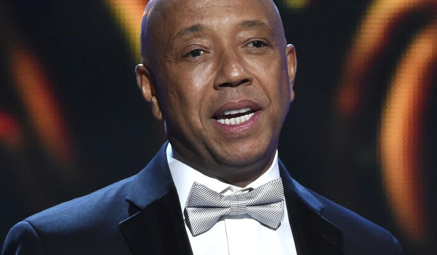 FILE - In this Feb. 6, 2015, file photo, hip-hop mogul Russell Simmons presents the Vanguard Award on stage at the 46th NAACP Image Awards in Pasadena, Calif. A Los Angeles woman is suing Simmons, alleging he raped her at his home in 2016. An attorney for 37-year-old Jennifer Jarosik filed the lawsuit Wednesday, Jan. 24, 2018. (Photo by Chris Pizzello/Invision/AP, File)