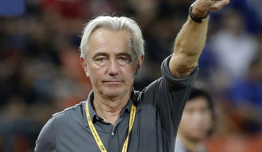 FILE - In this March 23, 2017, file photo, then Saudi Arabia's coach Bert Van Marwijk instructs his players during their World Cup qualifier soccer match against Thailand at Rajamangala national stadium in Bangkok, Thailand. World Cup final coach Van Marwijk has been appointed head coach of Australia for the World Cup in Russia. Football Federation Australia (FFA) chairman Steven Lowy said Thursday, Jan. 25, 2018, the Dutch coach's experience was the perfect blend for the Socceroos' Russian campaign. (AP Photo/Sakchai Lalit, File)