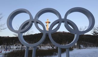 The Olympic rings are displayed at the Main Press Center for the 2018 Pyeongchang Winter Olympics in Pyeongchang, South Korea, Tuesday, Jan. 23, 2018. A team of South Korean officials travelled to North Korea on Tuesday to check logistics for joint events ahead of next month's Winter Olympics in the South, as the rivals exchanged rare visits to each other amid signs of warming ties. (AP Photo/Ahn Young-joon)