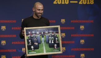 FC Barcelona's Javier Mascherano poses with a picture with FC Barcelona trophies during his farewell event at the Camp Nou stadium in Barcelona, Spain, Wednesday, Jan. 24, 2018. Barcelona have confirmed Javier Mascherano has signed with Chinese Super League outfit Hebei China Fortune after eight year in Barcelona. (AP Photo/Manu Fernandez)