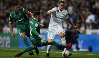 "Real Madrid's Marcos Llorente, right, vies for the ball with Leganes' Roberto Roman ""Tito"" during the Spanish Copa del Rey quarterfinal second leg soccer match between Real Madrid and Leganes at the Santiago Bernabeu stadium in Madrid, Wednesday, Jan. 24, 2018. (AP Photo/Francisco Seco)"