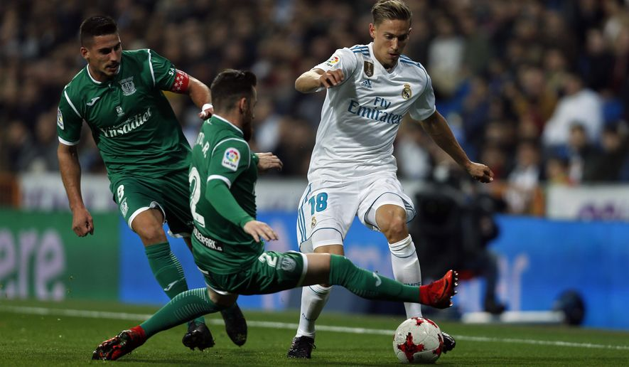 """Real Madrid's Marcos Llorente, right, vies for the ball with Leganes' Roberto Roman """"Tito"""" during the Spanish Copa del Rey quarterfinal second leg soccer match between Real Madrid and Leganes at the Santiago Bernabeu stadium in Madrid, Wednesday, Jan. 24, 2018. (AP Photo/Francisco Seco)"""