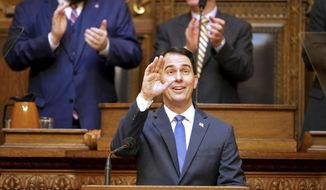 Wisconsin Governor Scott Walker held the State of the State Address Wednesday, Jan. 24, 2018 in the Assembly Chamber of the State Capitol in Madison, Wis.  (Steve Apps/Wisconsin State Journal via AP)