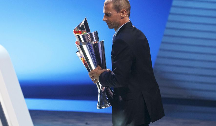 UEFA president Aleksander Ceferin holds the UEFA Nations League trophy, during the UEFA soccer Nations League draw, at the SwissTech Convention Center, in Lausanne, Switzerland, Wednesday, Jan. 24, 2018. (Salvatore Di Nolfi/Keystone via AP)