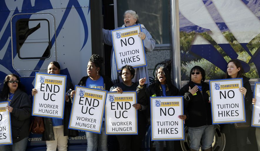 "File - In this Jan. 25, 2107, file photo, University of California employees, who are also members of the Teamsters Local 210, shout in protest against cuts in their benefits and tuition hikes outside of a University of California Board of Regents meeting in San Francisco. The University of California's governing board is scheduled to vote Wednesday, Jan. 24, 2018, on a plan to raise tuition for the second consecutive year after Gov. Jerry Brown proposed a budget increase of 3 percent and urged university officials to ""live within their means."" (AP Photo/Marcio Jose Sanchez, File)"