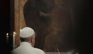 FILE - In this Saturday, April 8, 2017 file photo, Pope Francis prays in front of a portrait of the Virgin Mary as he arrives in at St. Mary Major Basilica in Rome to preside over a vigil prayer. Pope Francis' favorite icon of the Madonna in Rome has gotten a face-lift. The Vatican on Wednesday, Jan. 24, 2018 unveiled photos of the restored Salus populi Romani, a Byzantine-style painting on wood that is located inside the St. Mary Major Basilica. The incon will be officially displayed to the public Sunday, when Francis celebrates a special Mass at the basilica. (AP Photo/Alessandra Tarantino, File)