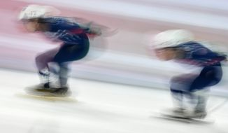 3026247 02/11/2017 From left: J.R. Celski (USA) and Thomas Insuk Hong (USA) during the men's 1000 meter quarterfinals at the 201617 ISU Short Track Speed Skating World Cup in Minsk. Vladimir Pesnya/Sputnik via AP
