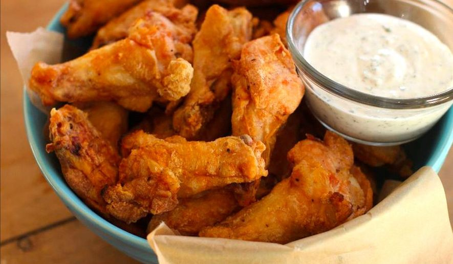"""A tasty chicken wing may become more expensive as Congress ponders a """"sin tax"""" on meats, including beef, pork and chicken. (Associated Press)"""