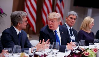 President Donald Trump listens during a dinner with European business leaders at the World Economic Forum on Thursday in Davos, Switzerland. He was joined by SAP CEO Bill McDermott (from left), Siemens CEO Joe Kaeser, and Secretary of Homeland Security Kirstjen Nielsen. (Associated PRess)