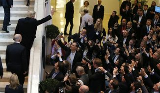U.S. President Donald Trump waves as he arrives during the annual meeting of the World Economic Forum in Davos, Switzerland, Thursday, Jan. 25, 2018. (AP Photo/Michael Probst)