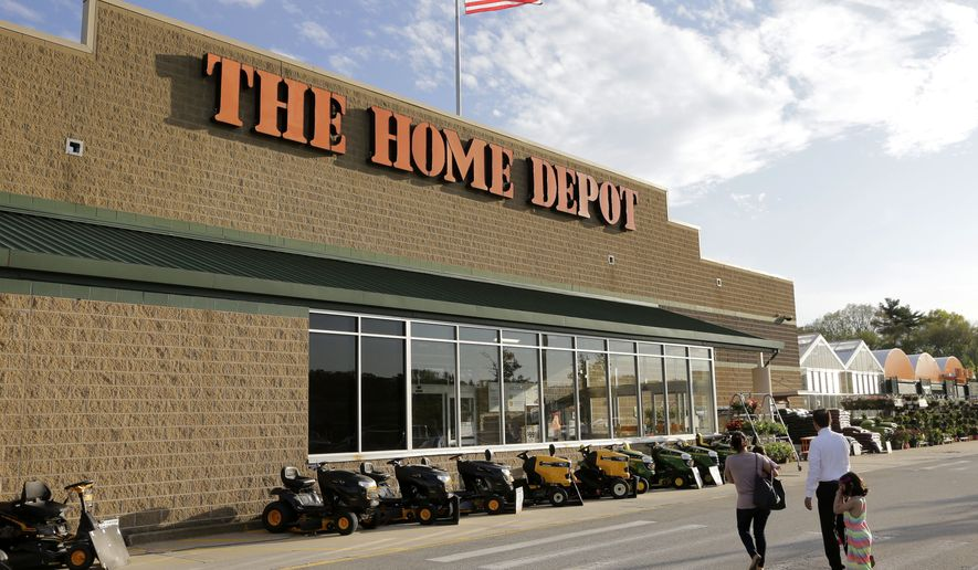 In this May 18, 2016, file photo, people approach an entrance to a Home Depot store in Bellingham, Mass. Home Depot is paying out one-time bonuses of up to $1,000 in cash to its hourly workers in the U.S., citing the recent tax overhaul. Home Depot Inc. said Thursday, Jan. 25, 2018, that the one-time bonus will be distributed in the current quarter. (AP Photo/Steven Senne, File)