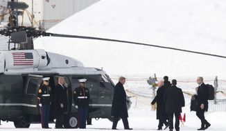 U.S. President Donald Trump, center, leaves Marine One as he arrives for the annual meeting of the World Economic Forum, WEF, in Davos, Switzerland, Thursday, Jan. 25, 2018. (Gian Ehrenzeller/Keystone via AP)