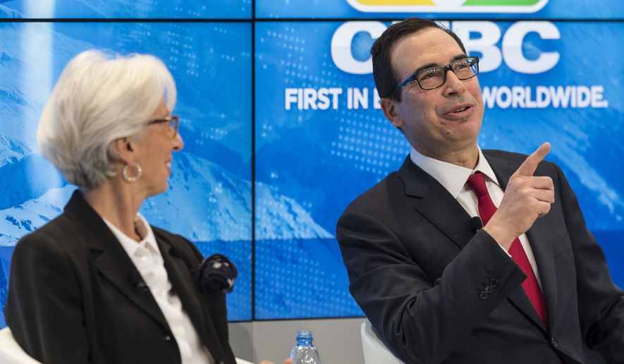 Christine Lagarde, managing director of the International Monetary Fund IMF, left, and Steven Mnuchin, secretary of the Treasury of the United States, attend a panel session during the 48th Annual Meeting of the World Economic Forum, WEF, in Davos, Switzerland, Thursday, Jan. 25, 2018. (Laurent Gillieron/Keystone via AP) ** FILE **