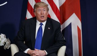 President Donald Trump speaks during a meeting with British Prime Minister Theresa May at the World Economic Forum, Thursday, Jan. 25, 2018, in Davos. (AP Photo/Evan Vucci)