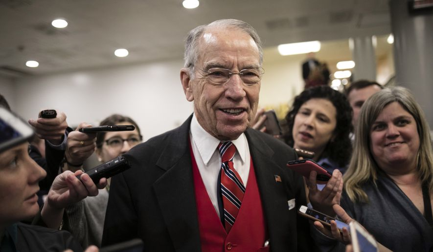 Senate Judiciary Committee Chairman Chuck Grassley, R-Iowa, speaks with reporters following a vote, at the Capitol in Washington, Thursday, Jan. 25, 2018. (AP Photo/J. Scott Applewhite) ** FILE **