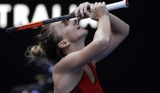 Romania's Simona Halep celebrates after defeating Germany's Angelique Kerber in their semifinal at the Australian Open tennis championships in Melbourne, Australia, Thursday, Jan. 25, 2018. (AP Photo/Dita Alangkara)