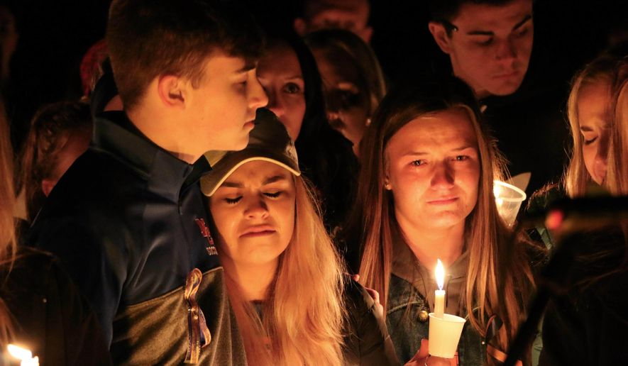People attend a vigil for the victims of a fatal shooting at Marshall County High School on Thursday, Jan. 25, 2018, at Mike Miller County Park in Benton, Ky. The 15-year-old accused of the fatal shooting on Tuesday, which left over a dozen injured, was ordered held Thursday on preliminary charges of murder and assault. (AP Photo/Robert Ray)