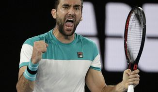 Croatia's Marin Cilic celebrates after taking the second set against Britain's Kyle Edmund during their semifinal at the Australian Open tennis championships in Melbourne, Australia, Thursday, Jan. 25, 2018. (AP Photo/Dita Alangkara)