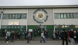 FILE - This is a Sunday, Jan. 4, 2015 file photo of fans as they gather ahead of the English FA Cup third round soccer match between Yeovil and Manchester United at Huish Park stadium in Yeovil, England. Manchester United  on Friday Jan. 26, 2018, takes on Yeovil in a fourth-round mismatch in the FA Cup. Yeovil lies 86 places lower in the English league pyramid and operates on a tight budget with players who are mostly free transfers, youngsters or players on loan to the club. (AP Photo/Alastair Grant/File)