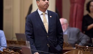 FILE - In this Jan. 3, 2018 file photo, state Sen. Tony Mendoza, D-Artesia, stands at his desk, at the Capitol in Sacramento, Calif., after announcing that he will take a month-long leave of absence while an investigation into sexual misconduct allegations against him are completed. The Senate Rules Committee voted 5-0, Thursday, Jan.25, 2018, to extend Mendoza's leave for 60 more days or until the investigation concludes. (AP Photo/Steve Yeater, file)