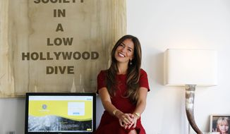 In this Jan. 12, 2018, photo, divorce attorney Laura Wasser, who has represented celebrities like Britney Spears and Johnny Depp, poses at her Century City office in Los Angeles. On Thursday, Jan. 25, Wasser is launching a new website and service called, It's Over Easy, that aims to help couples get divorced online without having to hire an attorney or set foot into a courthouse.  (AP Photo/Damian Dovarganes)