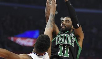 Boston Celtics guard Kyrie Irving shoots as Los Angeles Clippers guard Tyrone Wallace defends during the first half of an NBA basketball game Wednesday, Jan. 24, 2018, in Los Angeles. (AP Photo/Mark J. Terrill)