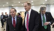 """While Republicans tack priorities onto the spending bill, Senate Appropriations Committee Chairman Richard C. Shelby (center) warned, """"You don't want to overload the truck."""" He is shown here with Sen. Doug Jones (left) Alabama Democrat, and Sen. John Kennedy, Louisiana Republican. (Associated Press/File)"""