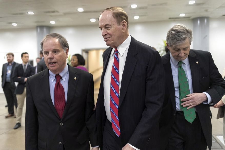 "While Republicans tack priorities onto the spending bill, Senate Appropriations Committee Chairman Richard C. Shelby (center) warned, ""You don't want to overload the truck."" He is shown here with Sen. Doug Jones (left) Alabama Democrat, and Sen. John Kennedy, Louisiana Republican. (Associated Press/File)"