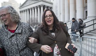Linda Lacewell, right, chief of staff to New York Gov. Andrew Cuomo, leaves a Manhattan Federal courthouse, Wednesday, Jan. 24, 2018, in New York. Lacewell testified Wednesday at Joseph Percoco's bribery trial. Opening statements were Tuesday at the trial of Percoco and three businessmen accused of paying him over $300,000 in bribes to help them get what they needed from the state.  (AP Photo/Mary Altaffer)