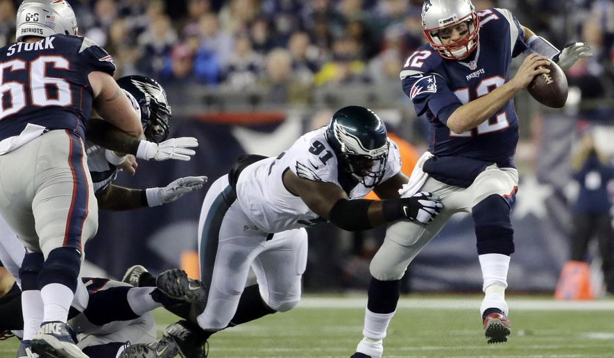 FILE- In this Dec. 6, 2015, file photo, New England Patriots quarterback Tom Brady (12) scrambles away from Philadelphia Eagles defensive end Fletcher Cox (91) during the first half of an NFL football in Foxborough, Mass. Cox, Malcolm Jenkins, Brandon Graham, Vinny Curry, Mychal Kendricks and Beau Allen are six key defensive players left from an Eagles team that beat Tom Brady and the Patriots 35-28 in Foxborough in December 2015 (AP Photo/Steven Senne, File)