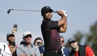 Tiger Woods watches his tee shot on the second hole hole of the South Course at Torrey Pines Golf Course during the first round of the Farmers Insurance Open golf tournament Thursday, Jan. 25, 2018, in San Diego. (AP Photo/Gregory Bull)