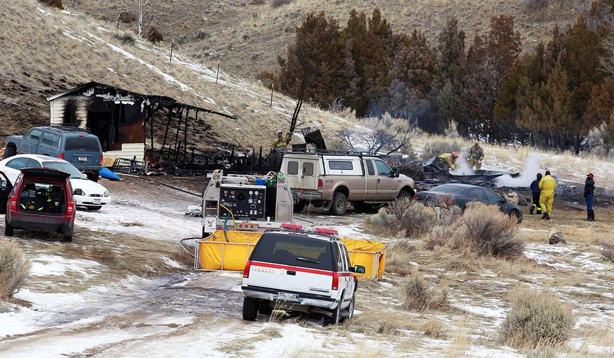 Emergency personnel work at the scene of a fatal fire in South Glastonbury, near Emigrant, Mont., Thursday, Jan. 25, 2018. The Park County sheriff's office says the fire was reported by neighbors just after 4 a.m. Thursday. The cause of the fire is under investigation. (Nate Howard/Livingston Enterprise via AP)