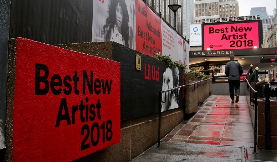 Signs posted around Madison Square Garden promote the return of the Grammy Awards to New York, Tuesday, Jan. 23, 2018, in New York. The Grammy Awards will be held on Sunday. (AP Photo/Bebeto Matthews)