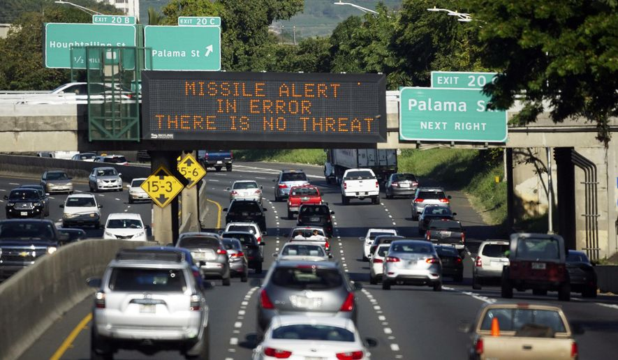 "FILE - In this Jan. 13, 2018, file photo provided by Civil Beat, cars drive past a highway sign that says ""MISSILE ALERT ERROR THERE IS NO THREAT"" on the H-1 Freeway in Honolulu. The Hawaii state employee who mistakenly sent the alert warning of a ballistic missile attack is refusing to cooperate with federal and state investigators, officials said Thursday, Jan. 25. (Cory Lum/Civil Beat via AP, File)"