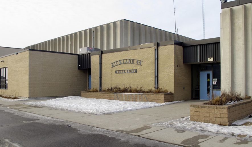 This Wednesday, Jan . 24, 2018, photo, shows an entrance to Richland High School in Colfax, N.D., where authorities are investigating alleged student misbehavior. School district Superintendent Tim Godfrey says the alleged misbehavior happened in the boys' locker room for seventh through 12th-graders. He says it might have involved sexual harassment. The Richland County Sheriff's Department is investigating. (AP Photo/Dave Kolpack)