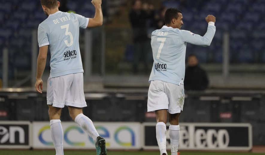 Lazio's Nani, right, celebrates with his teammate Stefan de Vrij after scoring during the Serie A soccer match between Lazio and Udinese, at the Rome Olympic stadium Wednesday, Jan. 24, 2018. (AP Photo/Gregorio Borgia)