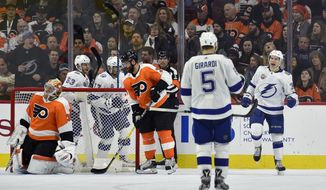 Tampa Bay Lightning's Yanni Gourde, right, celebrates after scoring a goal against Philadelphia Flyers goaltender Michal Neuvirth, left, during the second period of an NHL hockey game Thursday, Jan. 25, 2018, in Philadelphia. (AP Photo/Derik Hamilton)