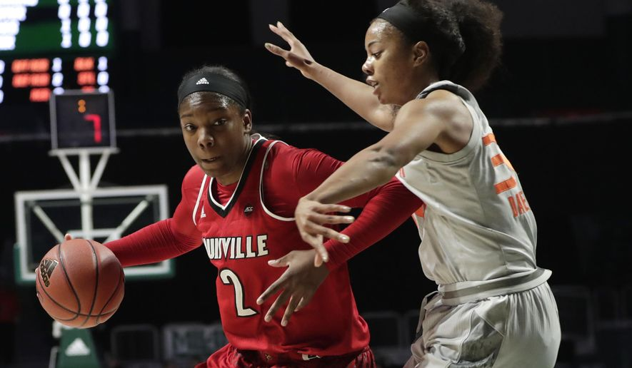 Louisville's Myisha Hines-Allen (2) drives to the basket as Miami's Erykah Davenport (30) defends during the first half of an NCAA college basketball game, Thursday, Jan. 25, 2018, in Coral Gables, Fla. (AP Photo/Lynne Sladky)