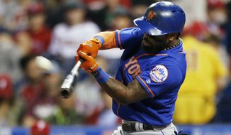 FILE - In this Sept. 29, 2017, file photo, New York Mets' Jose Reyes hits a home run in the first inning of a baseball game against the Philadelphia Phillies in Philadelphia. A person familiar with the negotiations says Reyes and the Mets have agreed to a $2 million, one-year contract for the infielder to remain in New York. The person spoke on condition of anonymity Thursday, Jan. 25, 2018, because the agreement was subject to a successful physical. (AP Photo/Laurence Kesterson, File)