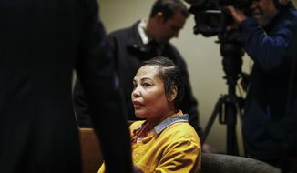 Sherra Wright makes an arraignment appearance in Judge Lee V. Coffee's courtroom Thursday, Jan. 25, 2018, in Memphis, Tenn., to face charges of killing her ex-husband NBA player Lorenzen Wright. (Mark Weber/The Commercial Appeal via AP)