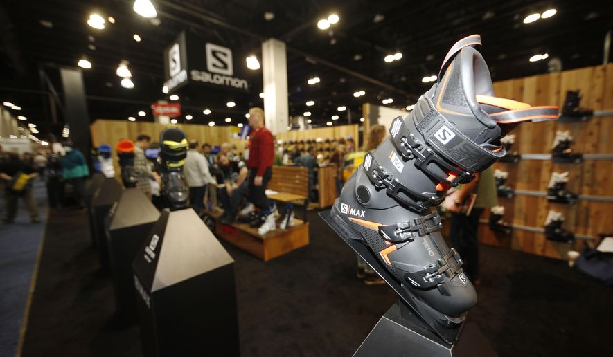 A ski boot appears on a display at the Salomon booth at the opening of the Outdoor Retailers and Snow Show in the Colorado Convention Center, Thursday, Jan. 25, 2018, in Denver. Three floors of all the latest products for outdoor use makes the event the largest U.S. trade show for the outdoor and winter sports industries that represent $887 billion in sales. (AP Photo/David Zalubowski)
