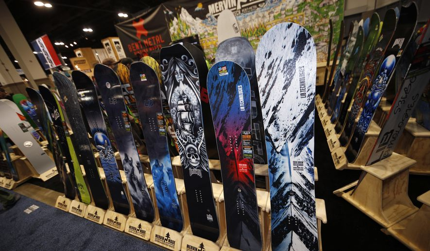 Snowboards are on display at the Mervin Made booth at the opening of the Outdoor Retailers and Snow Show in the Colorado Convention Center, Thursday, Jan. 25, 2018, in Denver. Three floors of all the latest products for outdoor use makes the event the largest U.S. trade show for the outdoor and winter sports industries that represent $887 billion in sales. (AP Photo/David Zalubowski)