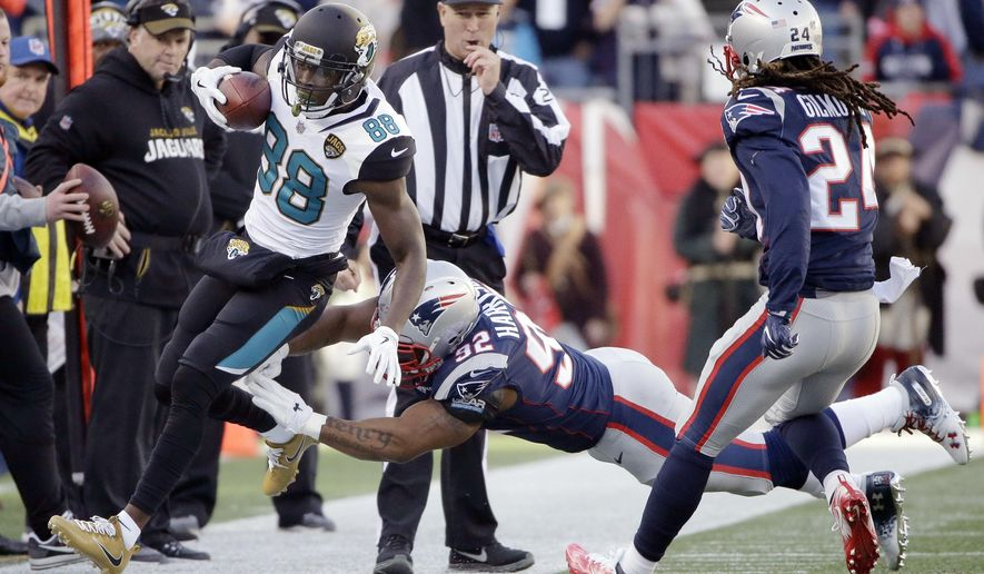 FILE - In this Sunday, Jan. 21, 2018, file photo, New England Patriots linebacker James Harrison (92) pushes Jacksonville Jaguars wide receiver Allen Hurns (88) out of bounds during the first half of the AFC championship NFL football game in Foxborough, Mass. Harrison has six tackles and a quarterback hit in the Patriots' two postseason wins.  (AP Photo/Steven Senne, File)