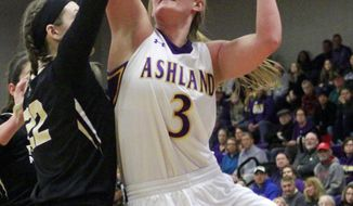 In this Jan. 13, 2018 photo, Ashland University's Laina Snyder (3) goes up for a shot against Purdue University Northwest's Ellie Michalski (22) during an NCAA women's basketball game at Kates Gymnasium in Ashland, Ohio. Snyder, the conference player of the year last season, already holds the school record for rebounds and likely will end her career as the all-time leading scorer. (Tom E. Puskar/The Times Gazette via AP)
