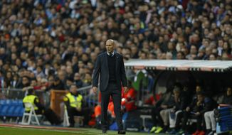 Real Madrid's head coach Zinedine Zidane follows the action from the side line during a Spanish La Liga soccer match between Real Madrid and Deportivo Coruna at the Santiago Bernabeu stadium in Madrid, Sunday, Jan. 21, 2018. Real Madrid defeated Deprtivo 7-1. (AP Photo/Francisco Seco)