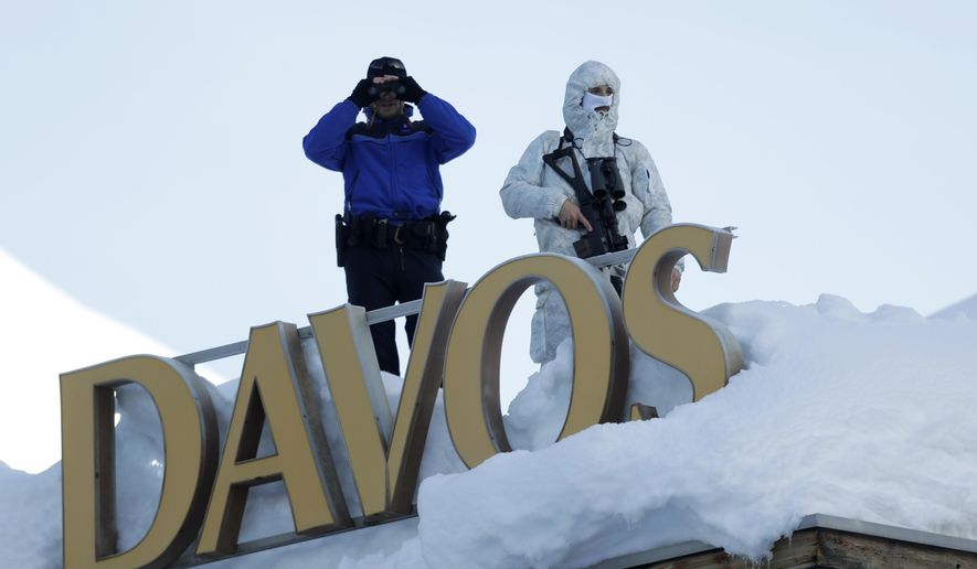 Soldiers guard the annual meeting of the World Economic Forum in Davos, Switzerland, Thursday, Jan. 25, 2018, hours before U.S. President Donald Trump is scheduled to arrive at the forum. (AP Photo/Markus Schreiber)