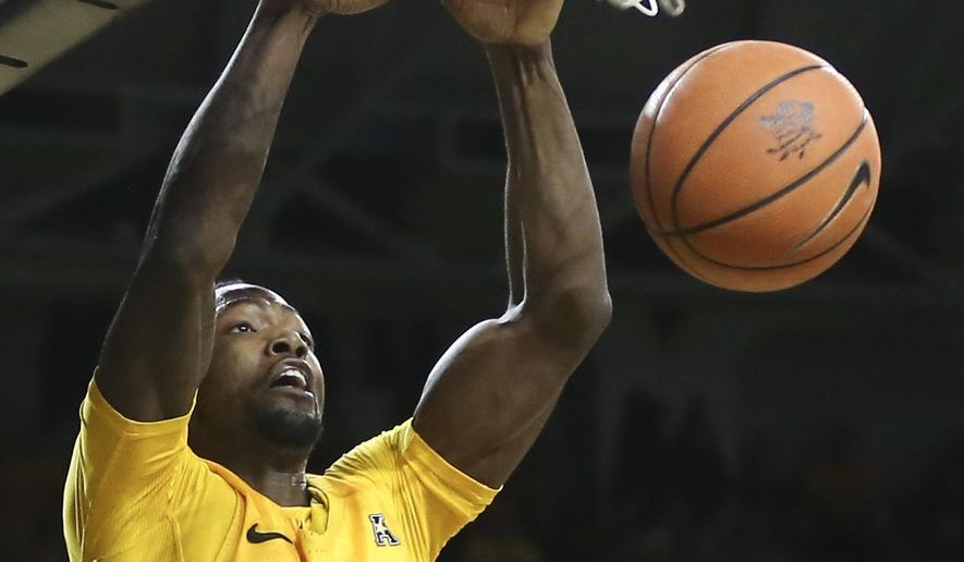 Wichita State forward Zach Brown dunks against Central Florida during the first half of an NCAA college basketball game Thursday, Jan. 25, 2018, in Wichita, Kan. (Travis Heying/The Wichita Eagle via AP)