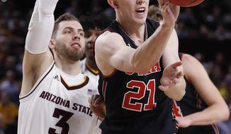 Utah forward Tyler Rawson (21) passes as Arizona State forward Mickey Mitchell (3) defends during the first half of an NCAA college basketball game, Thursday, Jan. 25, 2018,in Tempe, Ariz. (AP Photo/Matt York)