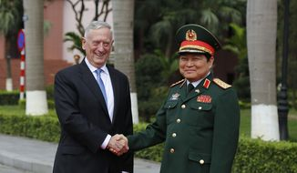 U.S. Defense Secretary Jim Mattis, left, shakes hands with his Vietnamese counterpart Ngo Xuan Lich, right, before reviewing and honor guard in Hanoi, Vietnam, Thursday, Jan. 25, 2018. Mattis is on a two-day visit to Vietnam to boost military ties between the two countries. (AP Photo/Tran Van Minh)